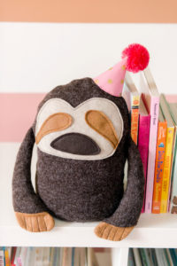 how to make a plushy bookend, sloth plushie pattern, sloth pattern, DIY sloth bookend, handmade bookend, janome sewing machine review, janome kids camp project