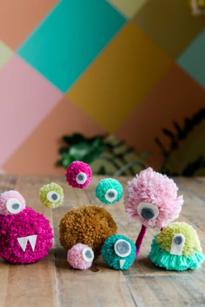 how to make a perfect yarn pom pom, pom pom monsters, how to make a pom pom monster, crafting through corona, kids craft ideas, kids crafting, kids rainy day activities